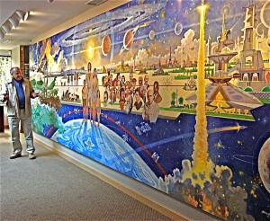 "Bob McCall speaks to ASAA members about his mural, ""Cosmic Revolution,"" in the Bellevue, Wash., headquarters of The Foundation for the Future."