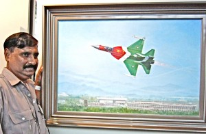 "S.M.A. Hussaini of Pakistan shows his painting, ""JF-17 Thunder Makes Public Debut."""