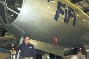 CAF president and CEO Steve Brown poses in front of the nose gear of Fifi in the CAF restoration hangar.