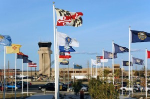 Wind buffets flags of the 50 states near the Laughlin Air Force Base control tower.