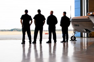 A crew of professionals from Immaculate Flight takes a quick breather at a hangar at Smith-Reynolds Airport (INT) in Winston-Salem, N.C., before taking on another aircraft detailing assignment.