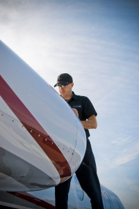 Jamie Yarborough of Immaculate Flight's team at Smith-Reynolds Airport in Winston-Salem puts some elbow grease into shining the top of an aircraft engine.