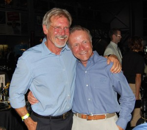 "Harrison Ford (left) and EAA President Tom Poberezny take a moment to pose for guests. Ford was absent from last year's gala while shooting the latest ""Indiana Jones"" film."