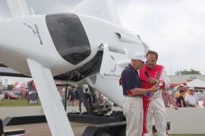 Tom Poberezny (left) and Granger Whitelaw discuss the first public performance of a Rocket Racing League aircraft.