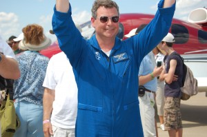 Kent Vandergrift acknowledges the crowd's applause after taxiing the SJ50 onto AeroShell Square.