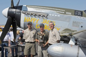 Mike VadeBonCoeur (center), Midwest Aero Restorations Ltd., in Danville, Ill., and his crew restored the 1944 P-51D Mustang Happy Jack's Go Buggy for FTR ESC LLC of San Antonio, Texas. The Mustang took the top honors at this year's Heritage Invitational.