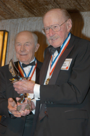 Bob Hoover (R) accepts the Freedom of Flight Award on 2005, from fellow Living Legend of Aviation General Chuck Yeager.