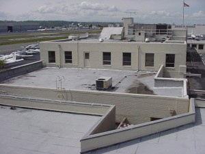 BEFORE: The terminal building roof of King County International Airport / Boeing Field before the grass was planted to assist in insulating the building.