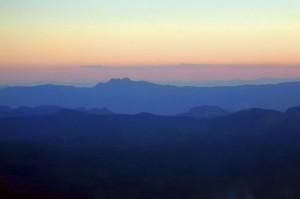 The sun sets over Four Peaks as we steer toward Scottsdale.