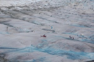As the helicopter flew closer to the base camp, the ice revealed itself as small but rugged hills with a strange aqua-blue glow in parts.