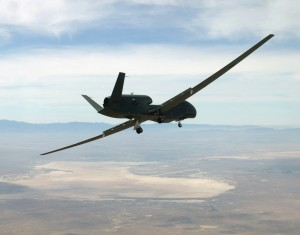 A U.S. Air Force RQ-4A Global Hawk high-altitude, long-endurance UAS turns over Roger Dry Lakebed to make a landing at Edwards Air Force Base (AFB), Calif. This is one UAS that officers with no flight training will learn to fly.