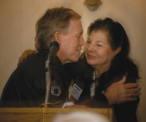 "Retired Brig. Gen. Steve Ritchie gives Aviation Hall of Fame president Bea Khan Wilhite a ""peck' on the cheek."
