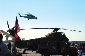 A Sikorsky S-76, owned by the Port Authority of New York and New Jersey, hovers in the background. The Marine Corps U-34 Choctaw in foreground made is first appearance at the show.