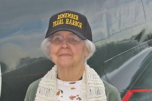 Martha Sue Stanley Cvijanovich posed by a Zero and recalled her Pearl Harbor experiences.