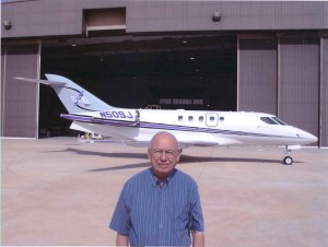 This recent photo finds Ed Swearingen showing off his most recent pride and joy, the SJ30 personal business jet that represents some of the engineer's most innovative designs.