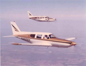 The Piper Aircraft Company became one of Ed Swearingen's best customers and he designed this single-engine turboprop prototype in the foreground for the company as well as the modified Piper Navajo in the background.