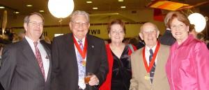 Howard Morgan, Ed Mehlin, Laura and Nick Nichols and Patty Morgan visit at a 2003 Wings Over the Rockies event.