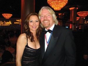 Natasha Pavlovich and Sir Richard Branson—as a founding member of Branson's first private space liner efforts, Pavlovich expects to make her spaceflight sometime next year.