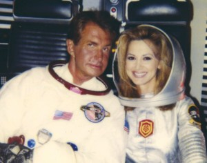 "George Hamilton, suited up as an astronaut, poses with Pavlovich during the filming of a TV episode of ""Jenny."" Pavlovich played the wife of a cosmonaut (played by Hamilton)."