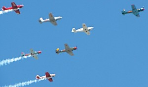 A variety of aircraft grace the skies in formation in the Sun'n Fun Air Show.