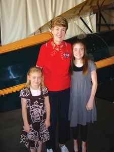Future journalists and pilots Alexis (left) and Haley Lips had the rare opportunity to spend some quality time with aviation legend Emily Howell-Warner (center).