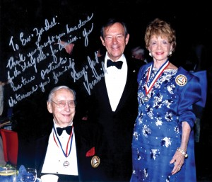 Autographed photo of Gov. Voinovich with Zoe Dell and Erv Nutter.