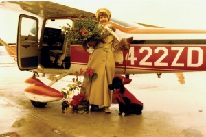 Here is Zoe Dell with her poodle. She regularly put C'est Si Bon on the cowling while she preflighted the airplane. This way her little companion was out of the way of other planes.