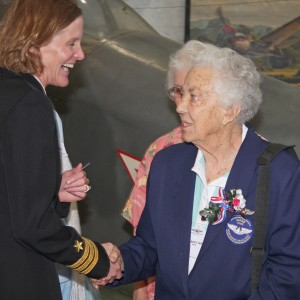 Flyers from past and present generations meet. Left to Right is Commander Valerie Overstreet, Margaret 'Pinky' Weiss WASP