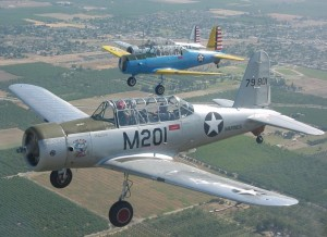 Formation of three Vultee B-13 Valiant trainers.