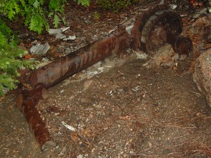 A rusting landing gear strut is seen here. Difficult terrain has limited the number of visitors to the site, and the few visitors have generally respected the remains.
