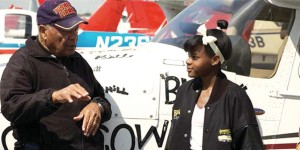 Tuskegee Airman Levi Thornhill and Kimberly Anyadike planning their trip, sponsored by Tomorrow's Aeronautical Museum (TAM).