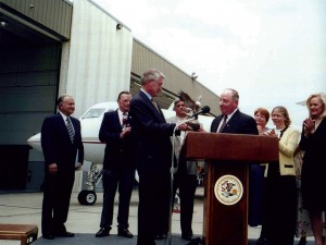 Gov. Jim Edgar presents Charles Priester with an award in the early 1990s. Priester and his father took a small cinder-packed runway and turned Palwaukee Airport into one of the leading general aviation airports in the country.