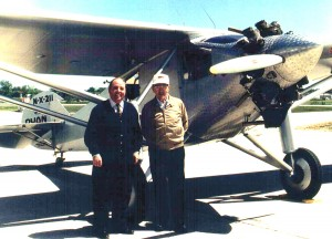 On the anniversary of Lindbergh's famous flight, George (right) and son Charlie pose in front of a replica of the Spirit of St. Louis.