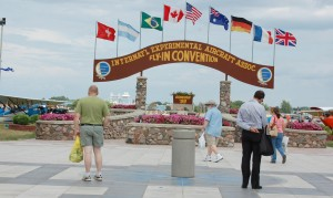 "At the dedication ceremony for the renewed ""Brown Arch"" EAA President Tom Poberezny said the stone and wood arch, with its flower planters, embodies the spirit of camaraderie and community that sets AirVenture apart from other world-class shows."